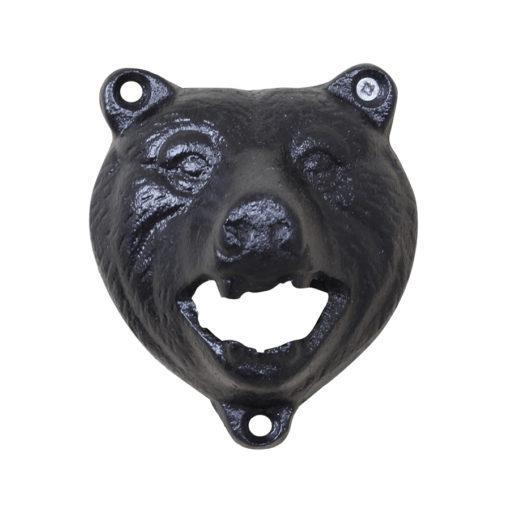 kapsylöppnare i formen av en björn. kapsylen tas av ,med hjälp av björnens tänder.
